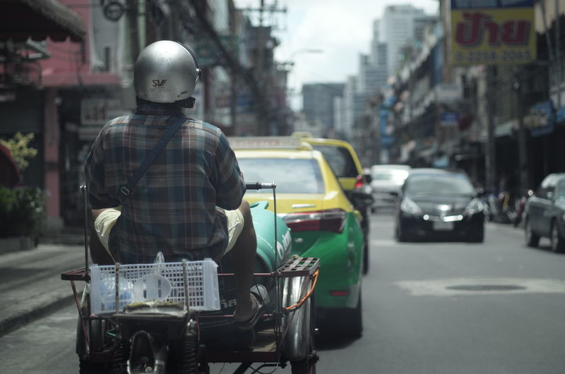 Modern freight tricycle in Bangkok, Thailand #shootwithLeica Freight Tricycles Carrier Bike Freight Bike Freight Bikes Cargo Bikes Leicacamera Real People Road Street Transportation first eyeem photo