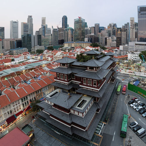Singapore, Singapore - October 18, 2018: Buddha Tooth Relic Temple in China Town at sunset Singapore Marina Bay Sands Merlion Haji Lane, Singapore Arab Street Cityscape Modern Art Museum Buddah Tooth Relic Temple Kampong Glam