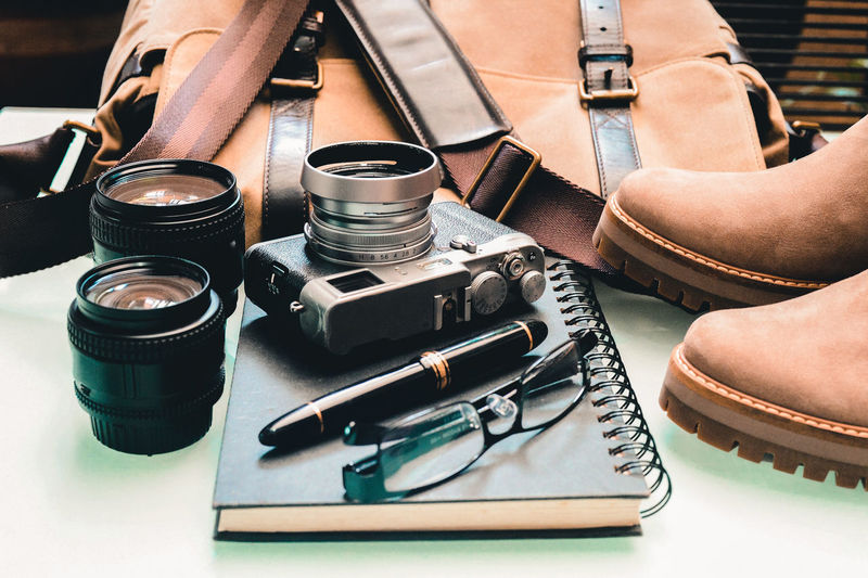 Digital Camera Photographic Equipment Close-up High Angle View Photography Themes Technology Travel Still Life Assignment Note Book Fountain Pen Shoes Camera Bag Packing On The Way Table Display