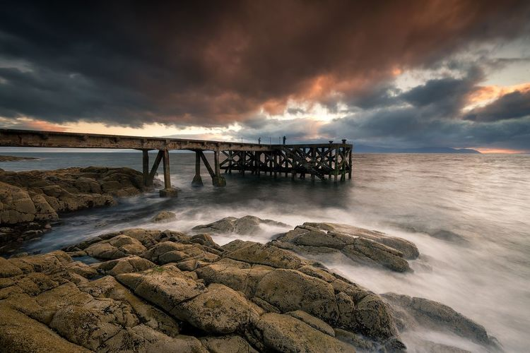 The old Pier Ayrshire Beach Sea Dramatic Sky Horizon Over Water Sunset Storm Cloud Scotland EyeEm Best Edits EyeEmNewHere EyeEm The Best Shots Landscape_Collection EyeEm Best Shots - Sunsets + Sunrise EyeEm Gallery