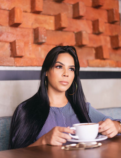 Portrait of young woman with coffee