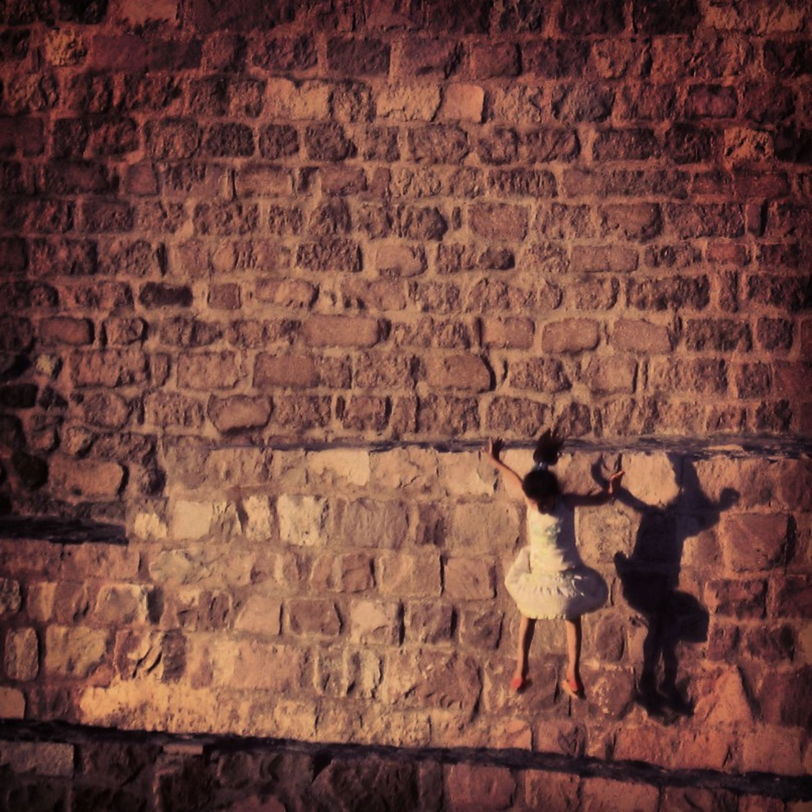 text, wall - building feature, brick wall, western script, architecture, built structure, wall, communication, stone wall, old, weathered, graffiti, textured, non-western script, history, art, art and craft, ancient, brick, building exterior