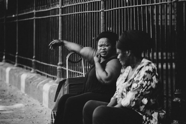 Ballaro' Palermo Blackandwhite Black & White Street Photography Real People Sitting People Leisure Activity Women Day The Street Photographer - 2018 EyeEm Awards Outdoors Two People Casual Clothing