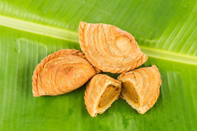 Malaysian Food Asian Food Banana Leaf Close-up Curry Puff Focus On Foreground Food Food And Drink Freshness Green Background Green Color Healthy Eating Indoors  Leaf Leaves No People Plant Part Ready-to-eat Snack Still Life Wellbeing