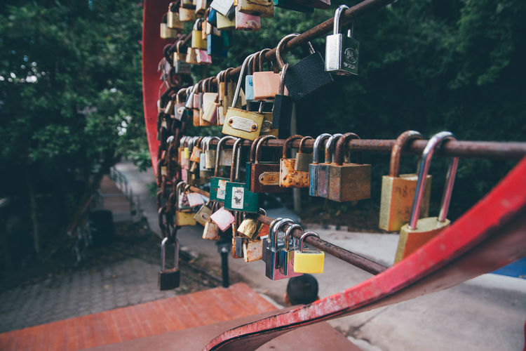 Close-up of padlocks hanging on railing