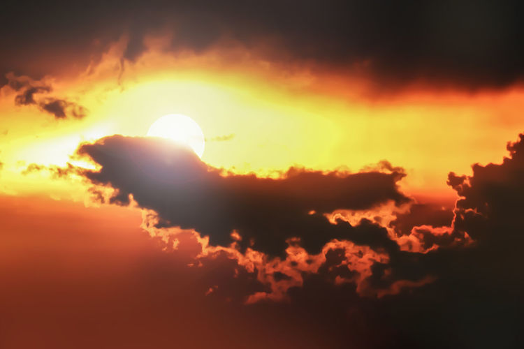Backgrounds Beauty In Nature Bright Cloud - Sky Cloudscape Dramatic Sky Eclipse Glowing Idyllic Low Angle View Majestic Nature No People Orange Color Outdoors Scenics - Nature Sky Sun Sunlight Sunset Tranquil Scene Tranquility
