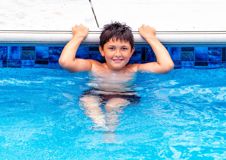 Portrait of happy boy in swimming pool