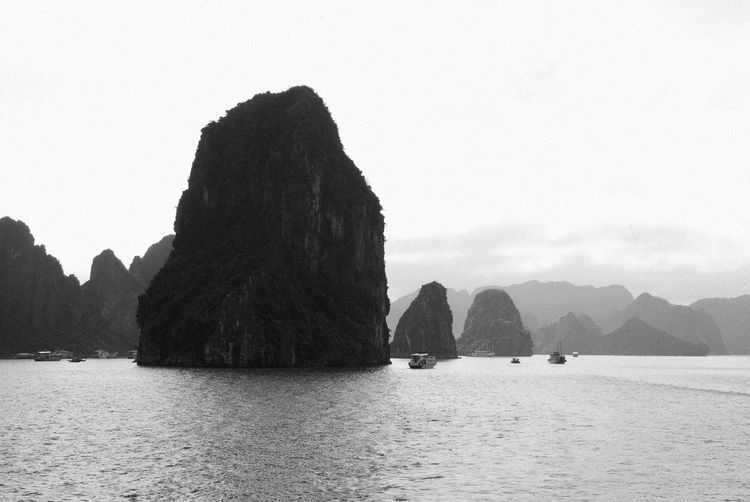 Beauty In Nature Black And White Black And White Photography Cliff Halong Bay Vietnam Headland Mid Distance Mountain Mountain Range Nature Ocean Rock Formation Scenics Sea Silhouette Sky Tranquil Scene Tranquility Vietnam Water Waterfront