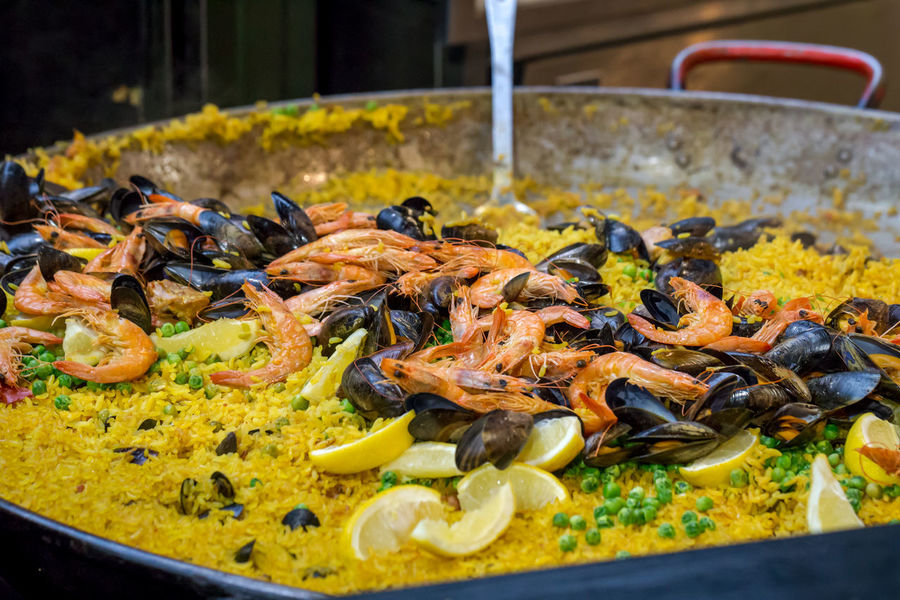 Paella Rice Seafood Shrimps Spanish Food Green Peas Healthy Eating Large Lemon Mussels No People Pan Peas Prawns Ready-to-eat Saffron Serving Spoon Traditional Yellow