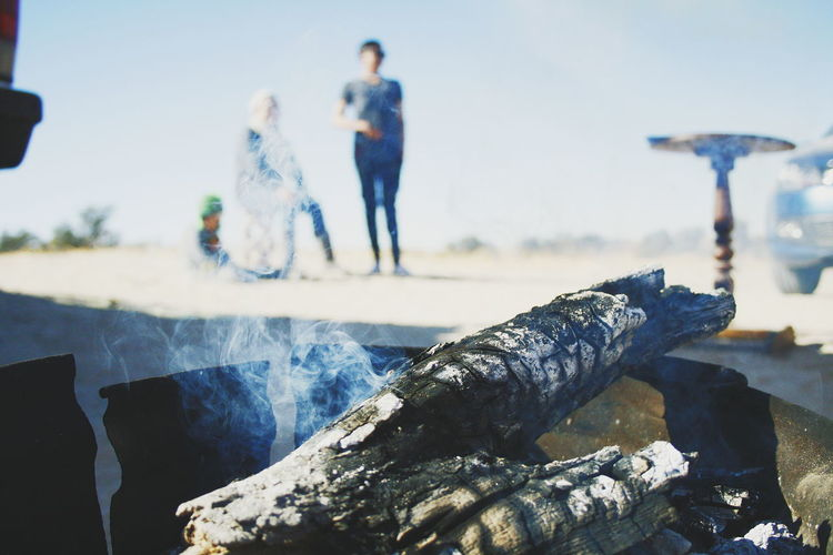 Focus Object Togetherness Day Three People Outdoors People Full Length Motion Adult Friendship Vacations Nature Men Adults Only Sky Golfer Fire Smoke Braai Relax Wood
