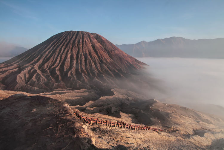 Magnificent view of Mount Bromo in Surabaya, Indonesia. EyeEm Best Shots EyeEm Nature Lover Foggy Weather INDONESIA Active Volcano Beauty In Nature Day Erupting Geology Landscape Mountain Mountain Range Nature No People Outdoors Physical Geography Scenics Sky This Week On Eyeem Tranquil Scene Tranquility Travel Destinations Volcanic Crater Volcanic Landscape Volcano