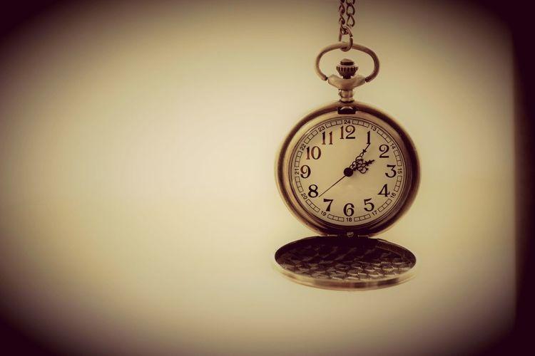Close-up of clock hanging
