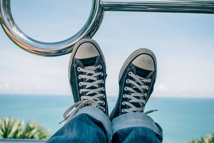 Blue Close-up Converse Day Horizon Over Water Human Body Part Human Leg Leisure Activity Lifestyles Low Section Men Nature One Person Outdoors Personal Perspective Real People Sea Shoe Sky Standing Water