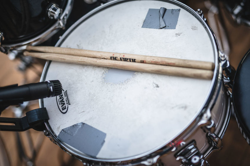Arts Culture And Entertainment Close-up Directly Above Drum Drum - Percussion Instrument Drum Kit Drumstick Equipment Focus On Foreground High Angle View Indoors  Metal Music Musical Equipment Musical Instrument No People Percussion Instrument Selective Focus Technology Wood - Material