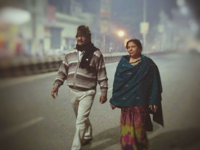 Night walk Warm Clothing Togetherness City Young Women Friendship Women Smiling Winter Happiness Full Length Senior Couple Arm In Arm Foggy Couple - Relationship Retirement Community Husband Married Walking Cane Senior Women Fall Falling In Love Young At Heart Dating Heterosexual Couple Retirement