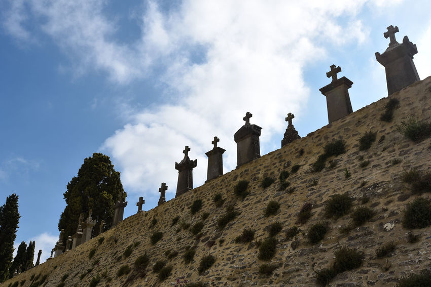Crosses and graves in cemetery in Carcassonne Carcassonne Cemetery Cross Fortified Wall France Grave Graveyard History Monument No People Outdoors Remember Remembering Stone Material The Past Wall