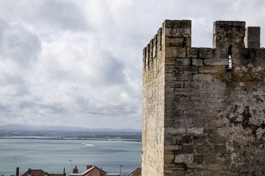 there's a castle in lisbon, from where you can dominated the world Architecture Built Structure Castle Castle View  Cloud - Sky Dominated By Her Eyes Lifestyles Outdoors Sky So High Stone Streetphotography Travel Destinations