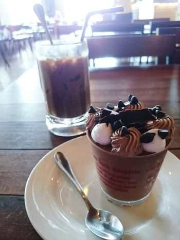 Cup Cake and Iced Coffee Sweet Food Dessert Chocolate Indoors  Drinking Glass Frozen Food Indulgence Food And Drink Drink Drinking Straw Unhealthy Eating Cold Temperature Temptation No People Ice Cream Food Frozen Sweet Food Day Ready-to-eat Scoop Shape ıced Coffee Cup Cake Cafe Chocolate Cake