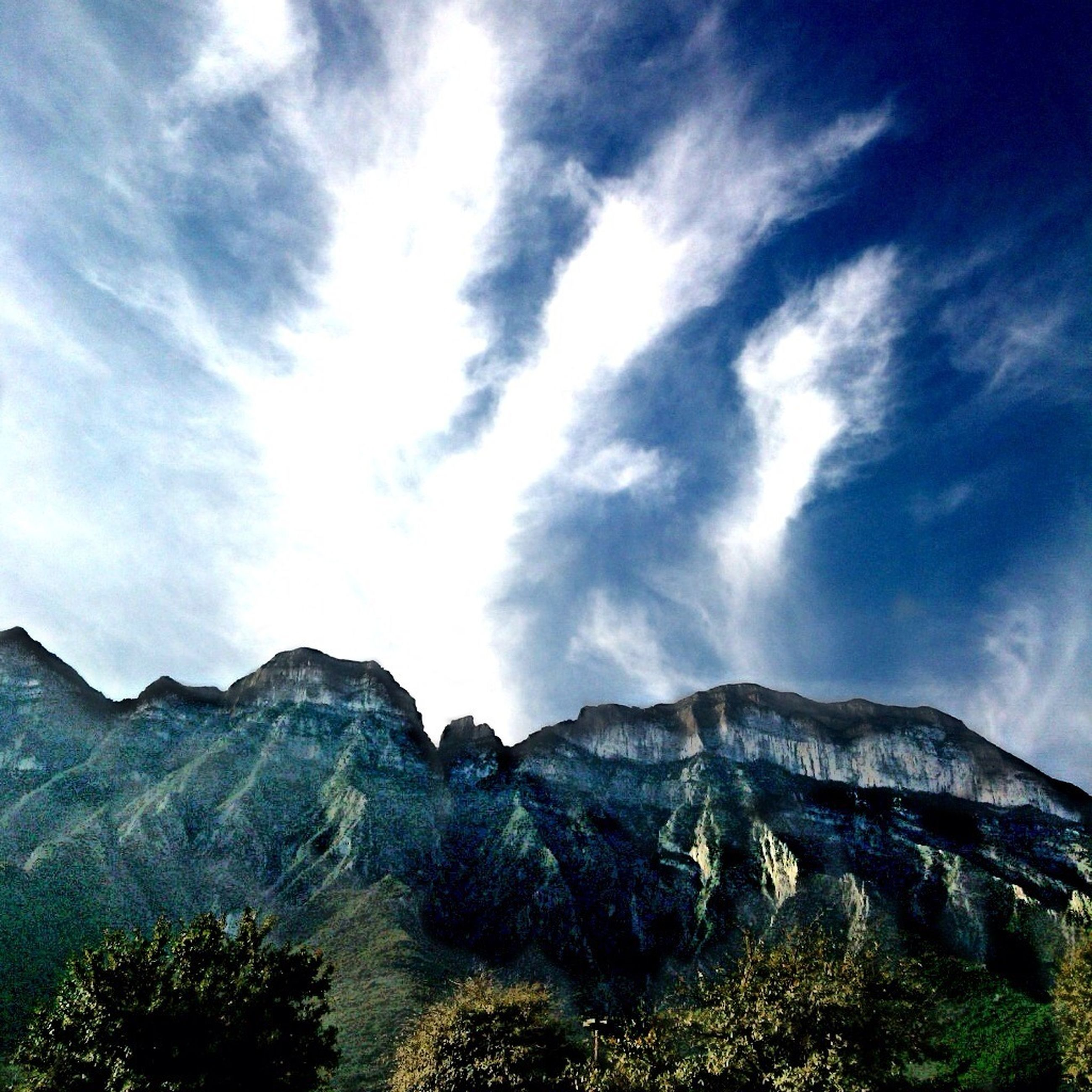 mountain, sky, mountain range, scenics, tranquil scene, tranquility, beauty in nature, cloud - sky, nature, landscape, cloud, non-urban scene, tree, cloudy, idyllic, low angle view, day, physical geography, remote, blue