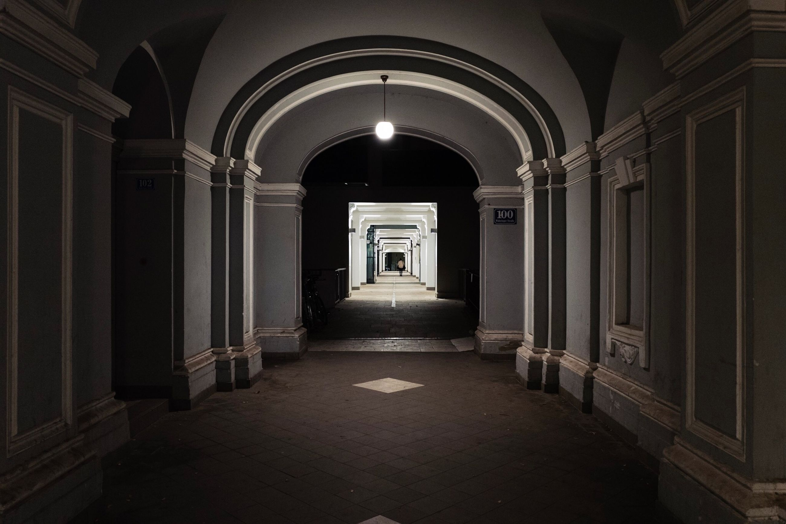 architecture, arch, building, built structure, the way forward, direction, arcade, indoors, door, no people, entrance, corridor, empty, absence, diminishing perspective, illuminated, lighting equipment, the past, history, day, ceiling, architectural column, long, aisle, arched