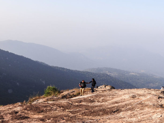 Couple standing on mountain
