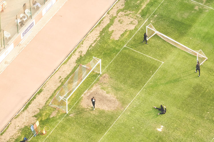 Adult Adults Only Aerial View American Football Field Competition Day Flying High Grass Green Color High Angle View Match - Sport Men Only Men Outdoors People Playing Racket Sport Sport Sports Team Sportsman