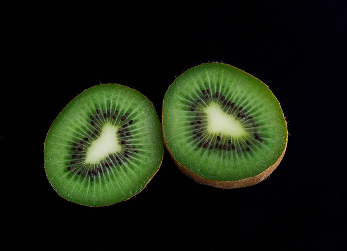 Food And Drink Studio Shot Food Kiwi Fruit Healthy Eating Wellbeing Black Background Cross Section SLICE Freshness Kiwi - Fruit Green Color Indoors  Still Life Close-up Cut Out No People Halved Seed Autumn Mood