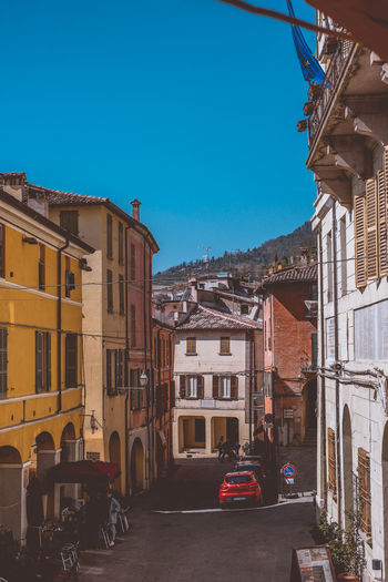 Street of the small town of Brisighella in Italy. Building Exterior Architecture Built Structure Building City Sky Transportation Residential District Nature Street Mode Of Transportation Day Clear Sky Motor Vehicle Land Vehicle Car Outdoors No People House Blue Italy Historic Houses MedievalTown