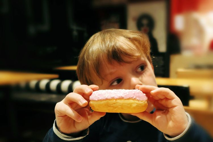 Close-Up Of Boy Holding Sweet Food