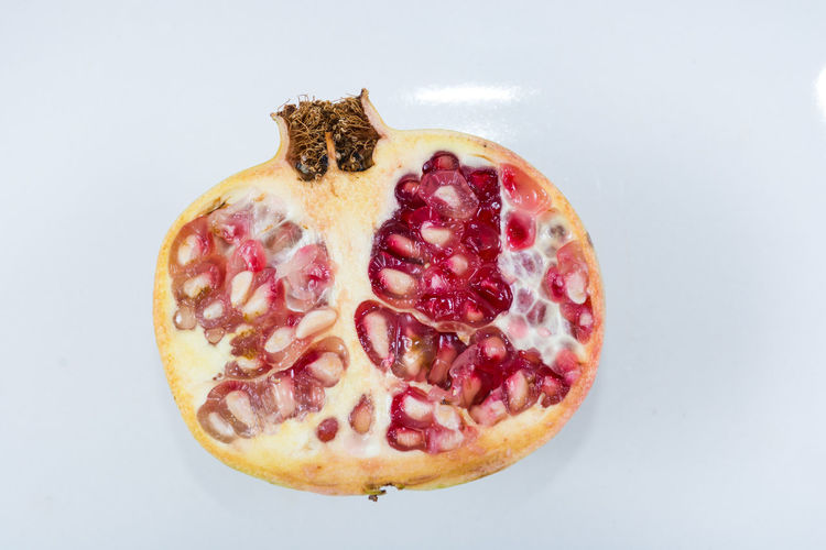 Pomegranates  Close-up Day Food Food And Drink Freshness Fruit Healthy Eating Indoors  No People Pomegranate Pomegranate Fruit Pomegranate Seed Ready-to-eat SLICE Studio Shot Sweet Food White Background