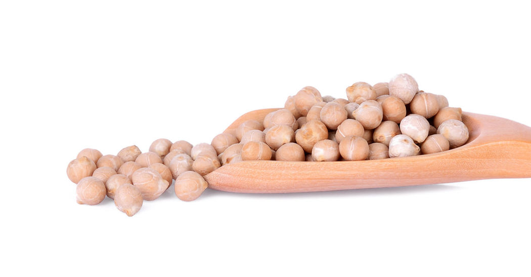 Close-up uncooked chickpeas in wooden spoon on white background. Isolated Natural Peace Raw Seed Vegetarian View Bean Chickpea Chickpeas Closeup Dry Food Fresh Grain Healthy Ingredient Legume Macro Nutrition Organic Uncooked Uncooked Pasta Vegetable White