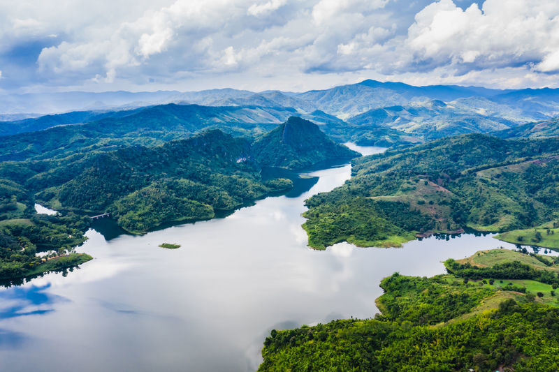 Reservoir in the valley in the rain season at chiang rai thailand aerial top view from drone