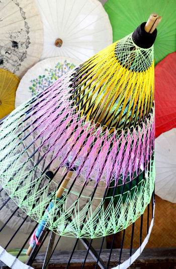 Structure of umbrella made of bamboo are handicraft in Thailand. Bamboo Umbrella Colorful Color Handmade Handicraft Indigenous  Art And Craft Craft Rope Structure Close-up Art Human Representation Statue Dark Chocolate ArtWork Craft Product Carving - Craft Product Male Likeness Needlecraft Product Fretboard Loom Peacock Feather Musical Instrument String Fanned Out Woolen Fabric Colored Pencil Modern Art