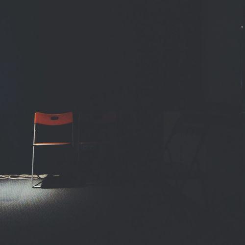 Empty Chair In Darkroom
