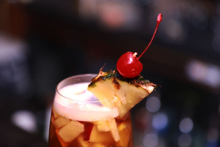 Close-up of cherries on glass