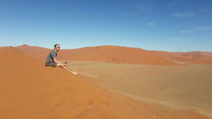 Full length of man on desert against sky