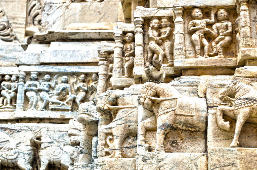 Ancient Architecture Art Art And Craft Built Structure Carving Carving - Craft Product Craft Creativity Day Historic History Human Representation No People Old Ornate Outdoors Sculpture Squirrel Statue Stone Material Temple Temple Wall The Past Travel Destinations