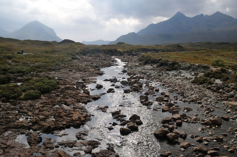 The River Sligachan with the red and black Cuillins in the background at Sligachan, Isle of Skye Cloudy Cuillins Highlands Landscape Mountain Mountain Range Non Urban Scene Non-urban Scene Remote River Sligachan Scenics Scotland Sky Skye Sligachan Tranquil Scene Tranquility