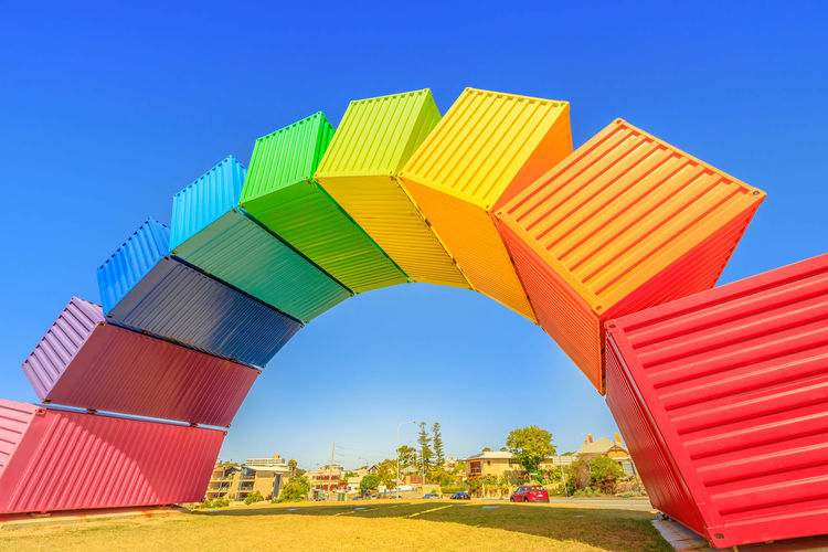 Perth rainbow bridge for visitors welcome. Rainbow Sea Container in Fremantle Port near Perth, Western Australia. Homosexuality and hope concept. Blue sky. Copy space. Freemantle Perth Perth Australia Western Australia Australia Australian Rainbow Bridge Colorful Rainbow Colors Rainbow🌈 Blue Sky Homosexual Love Plant Clear Sky Sky Blue Architecture Built Structure Nature No People Day Building Exterior Red Multi Colored Sunlight Low Angle View Outdoors Arch Green Color Copy Space Travel Destinations Building