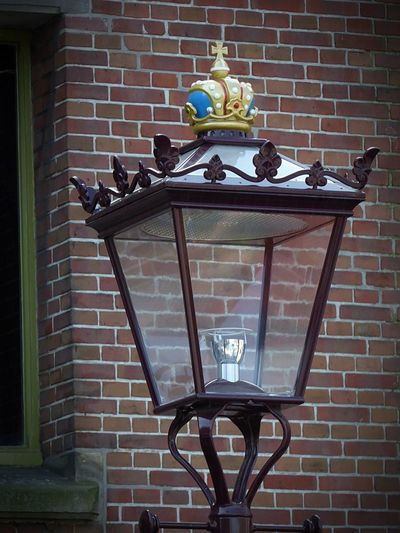 Old Style Metal Lamp Crown On Top Old City Lamp Brick Wall Wall Wall - Building Feature Brick Lighting Equipment No People Day Architecture Street Light Built Structure Electric Lamp Retro Styled Food Metal Decoration Flowering Plant Outdoors Old