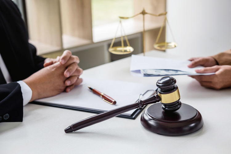 Midsection Of Lawyer Sitting At Table