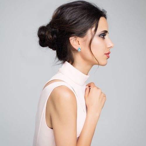 Portrait of young woman leaning on wall