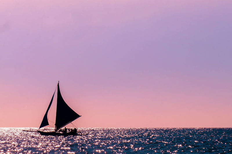Beach Beauty In Nature Clear Sky Horizon Over Water Nature Nautical Vessel Night No People Outdoors Sailboat Scenics Sea Sky Sunset Water