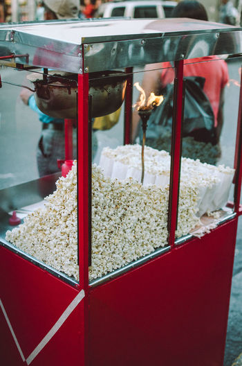 POPCorn Car Popcorn Abundance Business Choice Close-up Concession Stand Container Day Focus On Foreground Food Food And Drink For Sale Freshness Market Market Stall No People Outdoors Red Retail  Retail Display Snack Spice Store Streetphotography Variation