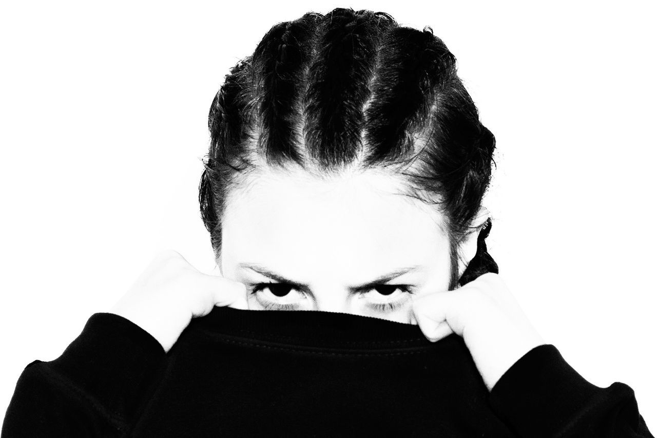Portrait of woman against white background