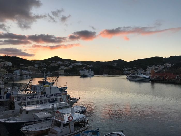 Sunset in island Ponza Sky Nautical Vessel Sunset Water Cloud - Sky Transportation Mode Of Transportation Harbor Moored No People Nature Building Exterior Beauty In Nature Outdoors Dusk Built Structure City Architecture Scenics - Nature Sea
