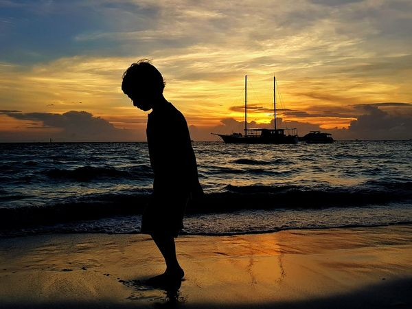 Gold on the beach Sunset Silhouette Beach Sea One Person Sky Water Cloud - Sky Sand Reflection Nature People Tranquility Scenics Outdoors Travel Destinations Full Length Standing Beauty In Nature Kids On Beach EyeEm Selects Connected By Travel