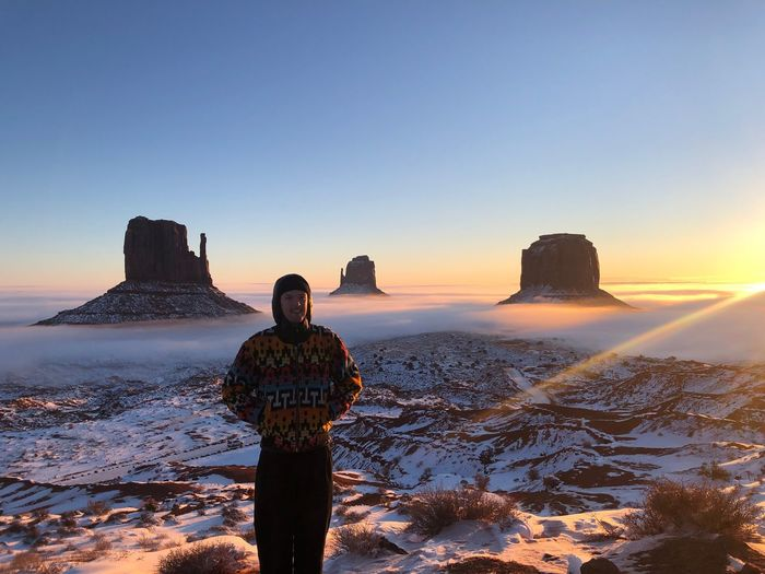 Monument Valley Winter sunrise Sky Beauty In Nature Sunset Scenics - Nature Water Sea Nature Land Tranquil Scene Clear Sky Tranquility Standing Rear View Copy Space One Person Idyllic Snow Real People Winter Horizon Over Water