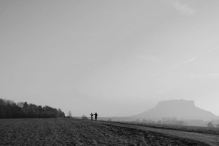 Outdoors Silhouette Landscape People Full Length Day Travel Destinations Beauty In Nature Mountain Range Mountainview Travel Blackandwhite Finding New Frontiers