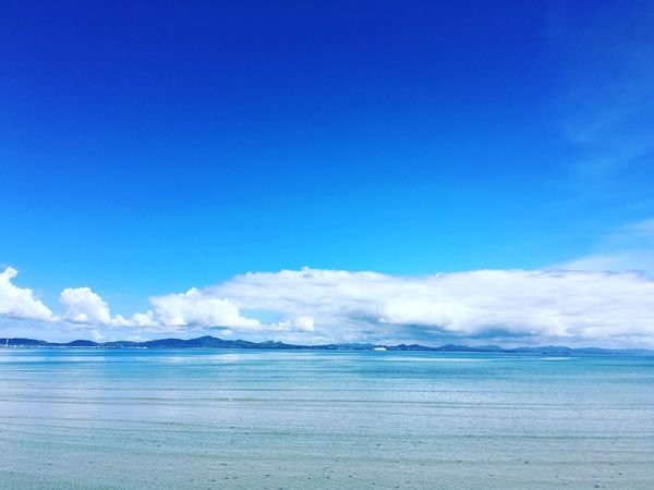Blue Scenics Water Beauty In Nature Sky Sea Nature Copy Space Cloud Waterfront Day Tourism Water Surface Non-urban Scene Majestic Outdoors